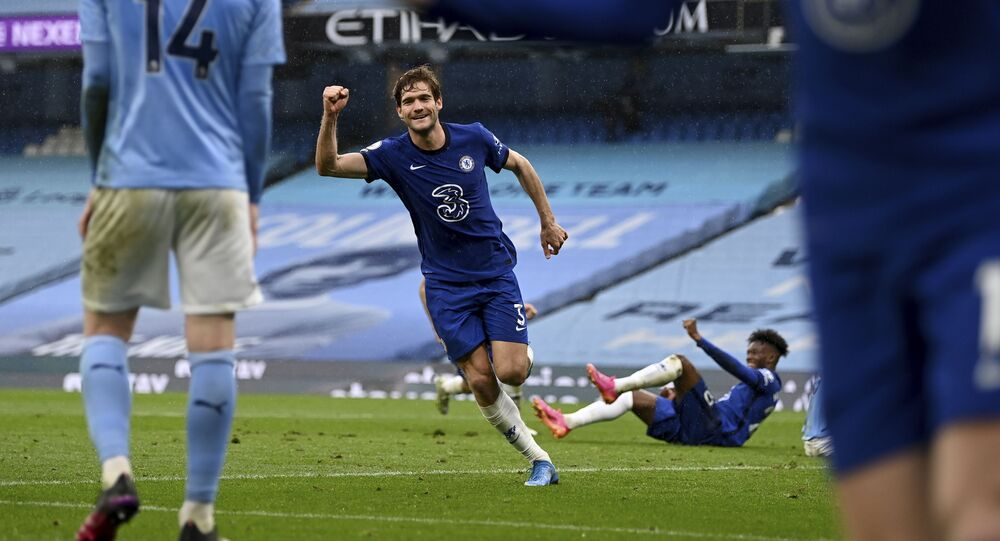 Chelsea's Marcos Alonso celebrates after scoring the winner in Premier League match against Manchester City in May 2021.