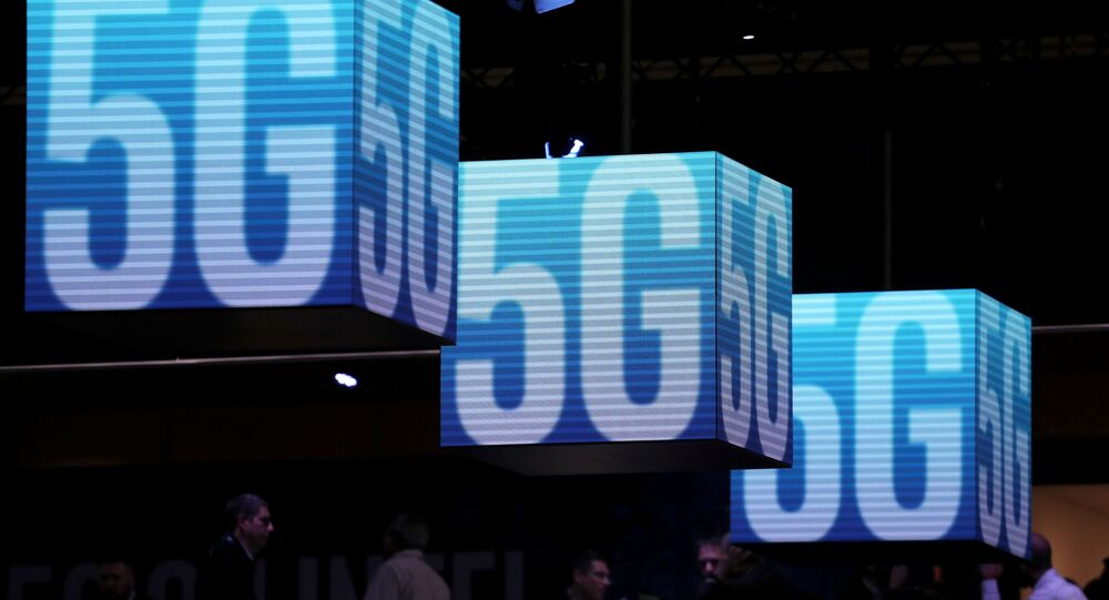 Hanging cubes display 5G logos at the Mobile World Congress in Barcelona, Spain, February 26, 2019. REUTERS/Sergio Perez/File Photo