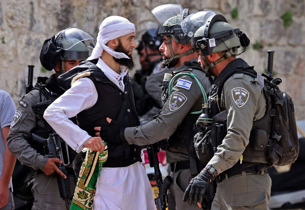 A Palestinian argues with Israeli security forces in Jerusalem's Old City ahead of a planned march to commemorate Israel's takeover of Jerusalem in the 1967 Six-Day War.