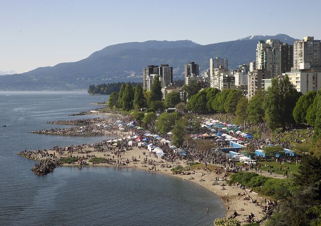 Thousands throng a beach in Vancouver, Canada during a drug festival in 2016