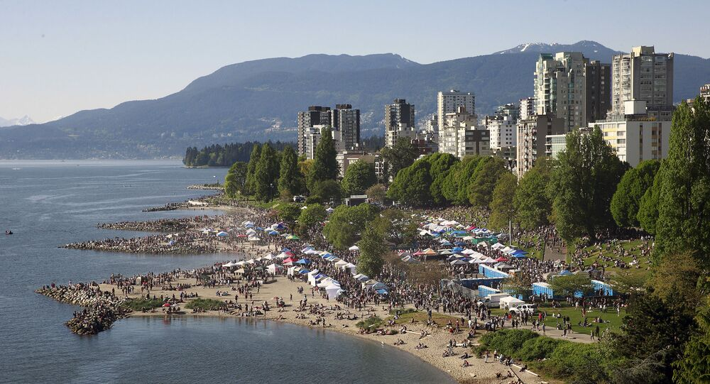 Thousands throng a beach in Vancouver, Canada during a drugs festival in 2016