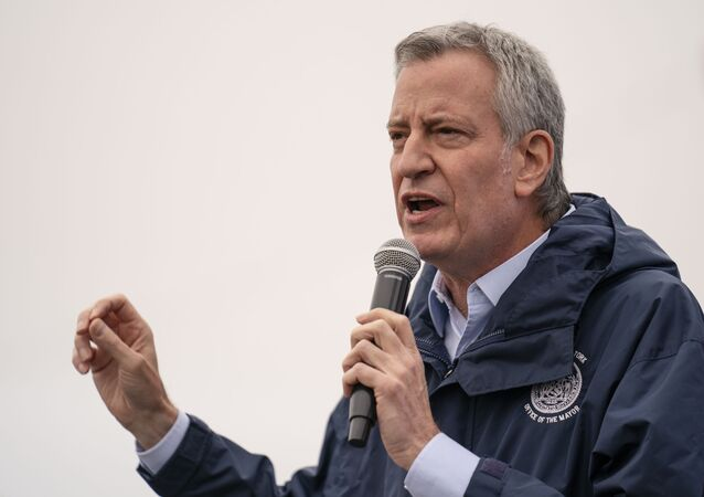 New York City Mayor Bill de Blasio speaks before the ribbon cutting and seasonal opening of the Coney Island amusement park area, Friday, April 9, 2021, in the Brooklyn borough of New York.