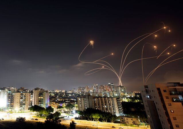 Streaks of light are seen as Israel's Iron Dome anti-missile system intercepts rockets launched from the Gaza Strip towards Israel, as seen from Ashkelon, Israel May 10, 2021.