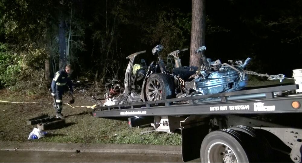 The remains of a Tesla vehicle are seen after it crashed in The Woodlands, Texas, April 17, 2021, in this still image from video obtained via social media