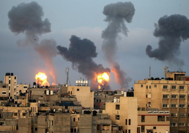 Flames and smoke rise during Israeli air strikes amid a flare-up of Israel-Palestinian violence, in the southern Gaza Strip May 11, 2021