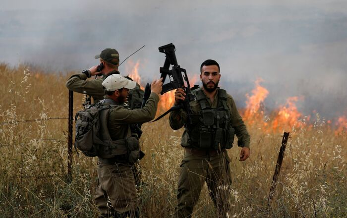 Israeli soldiers fight fire, after Palestinians in Gaza sent incendiary balloons over the border, near Nir Am, southern Israel May 9, 2021
