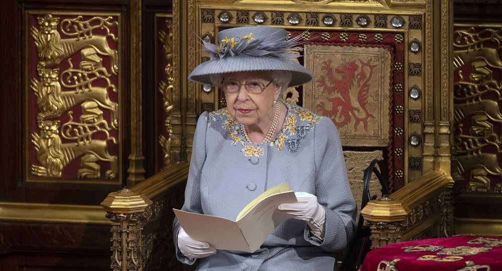 Britain's Queen Elizabeth II delivers the speech in the House of Lords during the State Opening of Parliament at the Palace of Westminster in London, Tuesday May 11, 2021. (Eddie Mulholland/Pool via AP)
