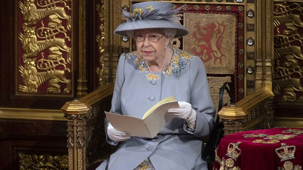 Britain's Queen Elizabeth II delivers the speech in the House of Lords during the State Opening of Parliament at the Palace of Westminster in London, Tuesday May 11, 2021. (Eddie Mulholland/Pool via AP) - Sputnik International