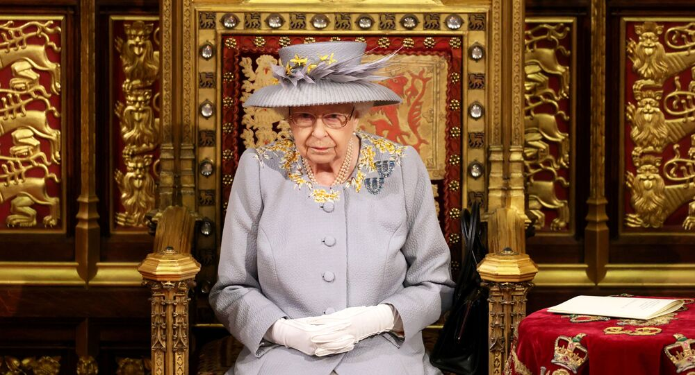 Britain's Queen Elizabeth sits ahead of the Queen's Speech in the House of Lord's Chamber during the State Opening of Parliament in London, Britain May 11, 2021