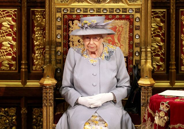 Britain's Queen Elizabeth sits ahead of the Queen's Speech in the House of Lord's Chamber during the State Opening of Parliament in London, Britain, 11 May 2021
