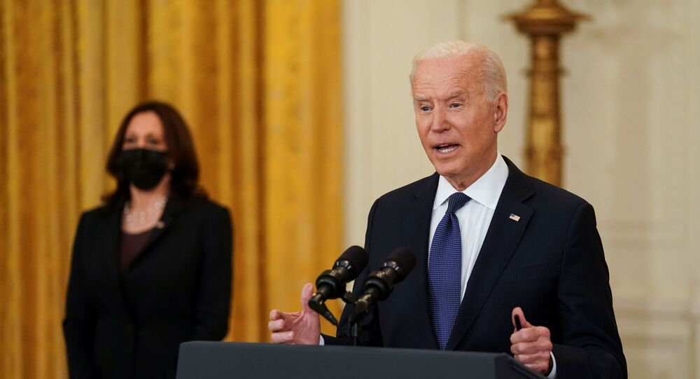 U.S. President Joe Biden delivers remarks on the U.S. economy as Vice President Kamala Harris stands by in the East Room at the White House in Washington, U.S., May 10, 2021