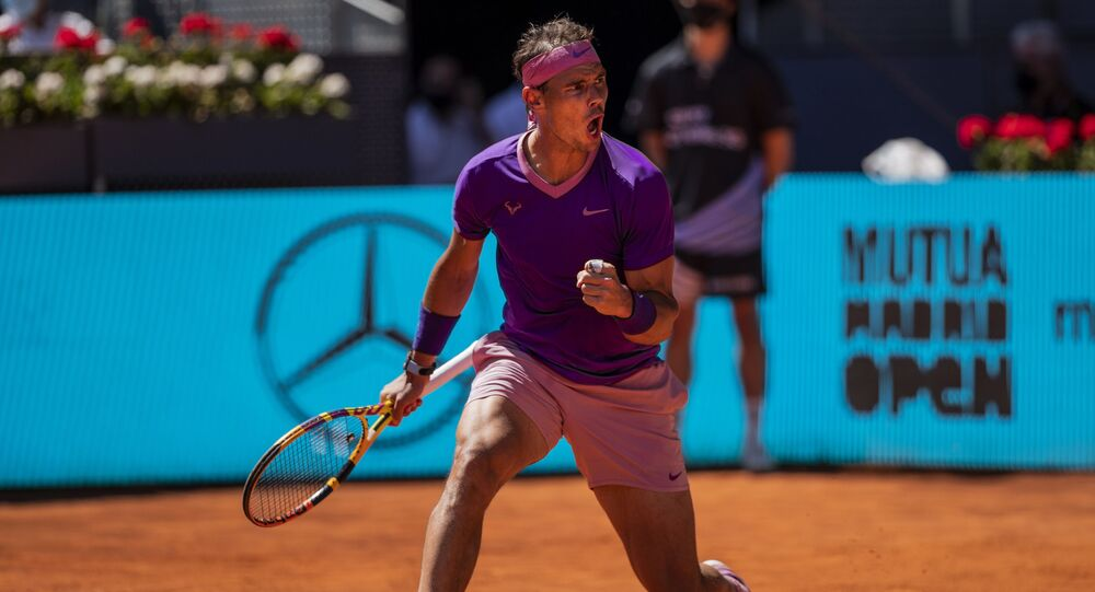 Spain's Rafael Nadal celebrates a point against Germany's Alexander Zverev during their match at the Mutua Madrid Open tennis tournament in Madrid, Spain, Friday, May 7, 2021