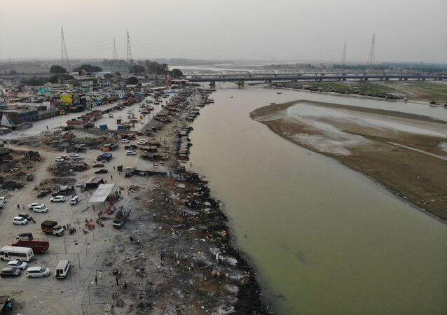 In this aerial photograph taken on May 5, 2021 funeral pyres of Covid-19 coronavirus victims are seen in a cremation ground along the banks of the Ganges River, in Garhmukteshwar