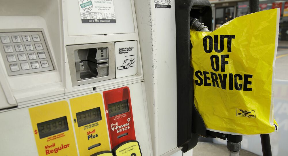 A gasoline station that ran out of gas for sale displays an out of service sign on the pump on Tuesday, May 11, 2021, in Atlanta. Gasoline futures are ticking higher following a cyberextortion attempt on the Colonial Pipeline, a vital U.S. pipeline that carries fuel from the Gulf Coast to the Northeast.
