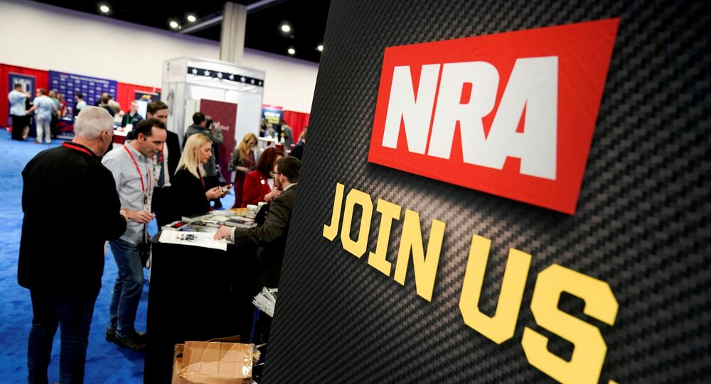 Attendees sign up at the National Rifle Association (NRA) booth at the Conservative Political Action Conference (CPAC) annual meeting at National Harbor in Oxon Hill, Maryland, U.S., February 27, 2020.