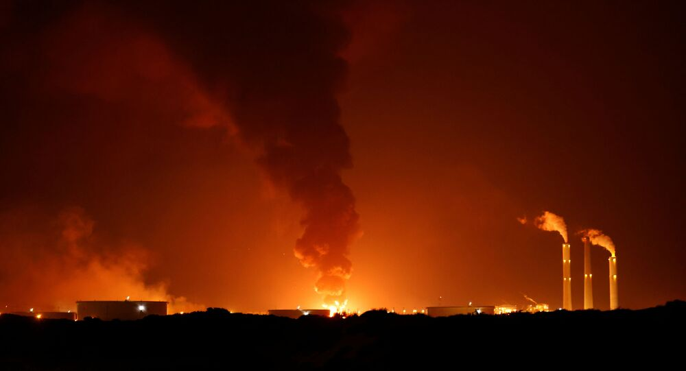 A large fire is seen near the scene of what officials said was a Gaza rocket attack on an Israeli energy pipeline near Ashkelon, Israel, May 11, 2021.