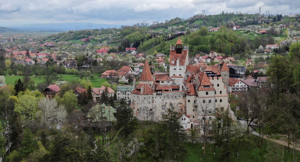 Bran Castle towers above Bran commune, in Brasov county, Romania, May 8, 2021. Picture taken with a drone.