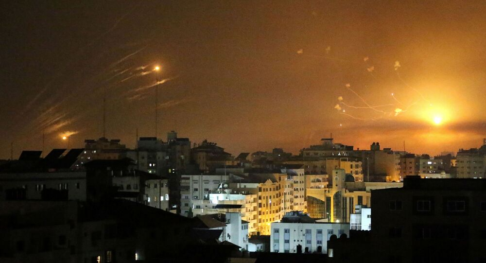 Israel's Iron Dome anti-missile system fires interceptor missiles as rockets are launched from the Gaza Strip towards Israel, in Gaza May 12, 2021.
