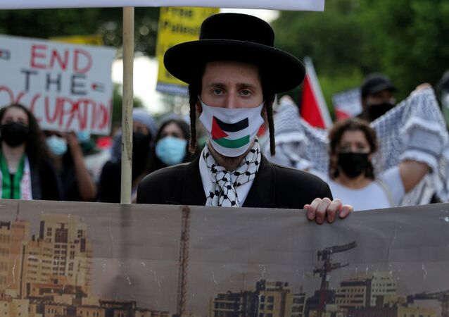 """Pro-Palestinian demonstrators march in a protest titled """"Stop Jerusalem Expulsions, save Sheikh Jarrah"""" from the U.S. State Department in Washington, U.S. May 11, 2021."""