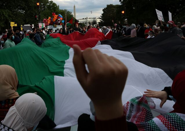 """Pro-Palestinian demonstrators take part in a protest titled """"Stop Jerusalem Expulsions, save Sheikh Jarrah"""" outside of the White House in Black Lives Matter Plaza after marching from the U.S. State Department building in Washington, U.S. May 11, 2021."""
