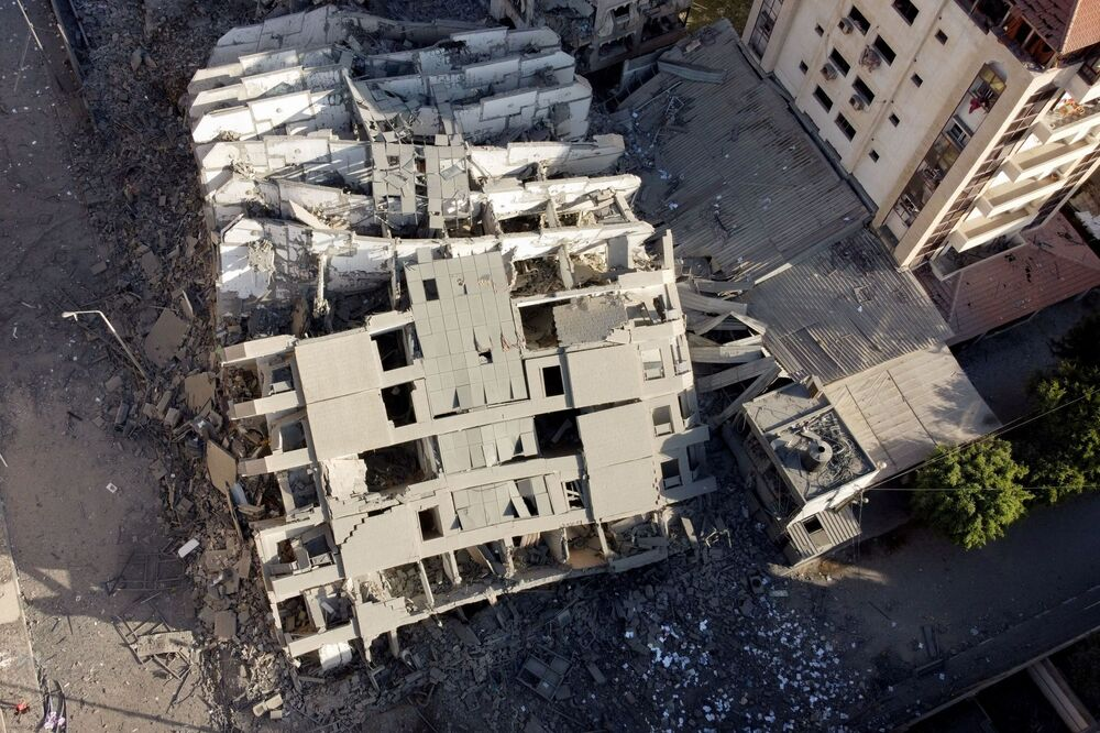 A picture taken with a drone shows the remains of a tower building which was destroyed in Israeli air strikes, amid a flare-up of Israeli-Palestinian violence, in Gaza City, 12 May 2021.