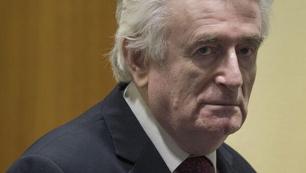 Former Bosnian Serb leader Radovan Karadzic enters the court room of the International Residual Mechanism for Criminal Tribunals in The Hague, Netherlands, Wednesday, March 20, 2019 - Sputnik International