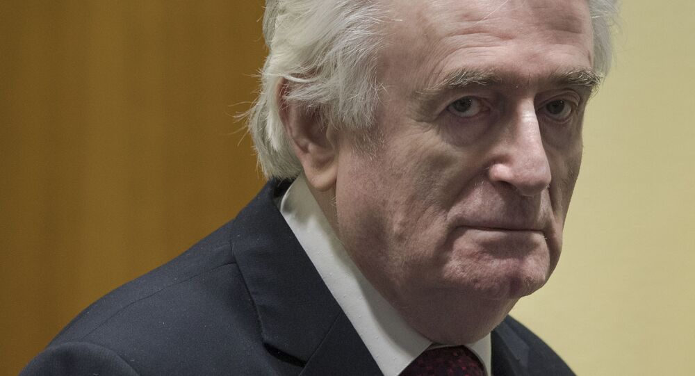 Former Bosnian Serb leader Radovan Karadzic enters the court room of the International Residual Mechanism for Criminal Tribunals in The Hague, Netherlands, Wednesday, March 20, 2019