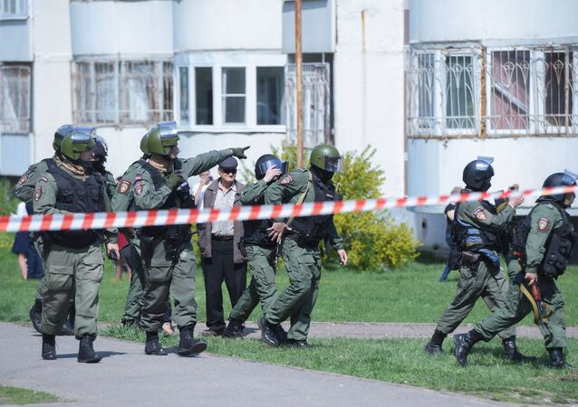 Riot police officers work at the scene of a shooting at Gymnasium No. 175 in Kazan, Russia's Republic of Tatarstan. According to preliminary data, six schoolchildren and a teacher were killed
