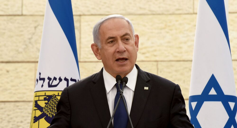 Israeli Prime Minister Benjamin Netanyahu speaks at a ceremony for fallen soldiers of Israel's wars at the Yad Lebanim House on the eve of Memorial Day, in Jerusalem, April 13, 2021. Debbie Hill/Pool via REUTERS