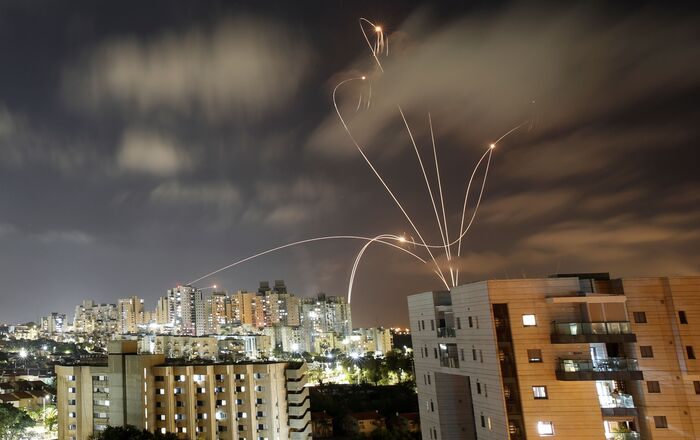 Streaks of light are seen as Israel's Iron Dome anti-missile system intercepts rockets launched from the Gaza Strip towards Israel, as seen from Ashkelon, Israel May 12, 2021.