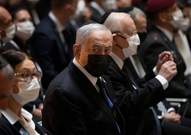 Israeli Prime Minister Benjamin Netanyahu attends an official ceremony marking Israel's Memorial Day, which commemorates Israel's fallen soldiers and Israeli victims of hostile attacks, at Mount Herzl military cemetery in Jerusalem April 14, 2021.
