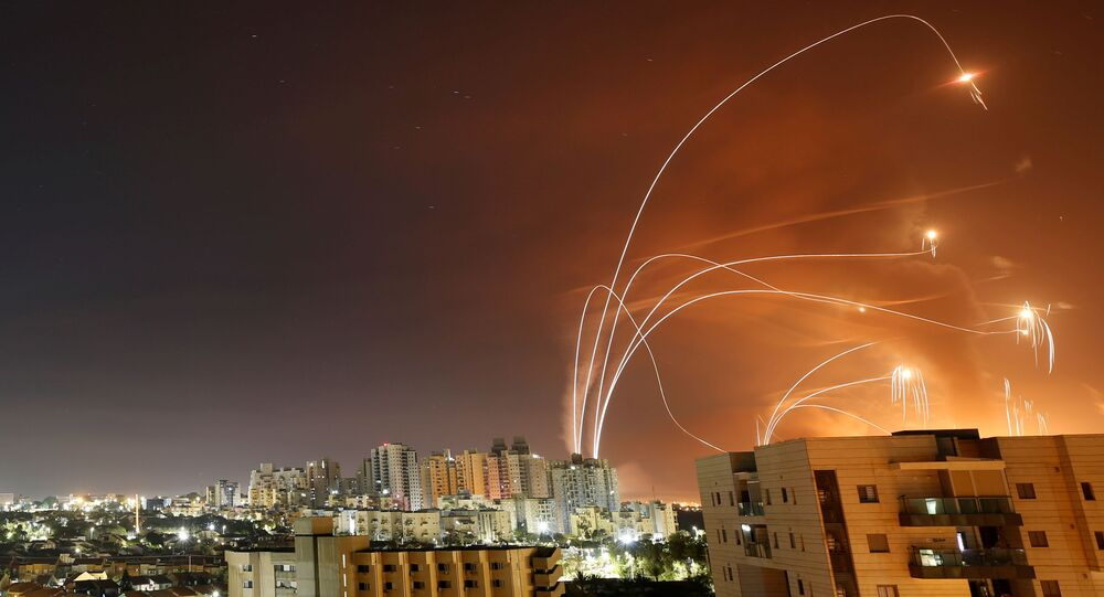 Streaks of light are seen as Israel's Iron Dome anti-missile system intercept rockets launched from the Gaza Strip towards Israel, as seen from Ashkelon, Israel May 12, 2021.