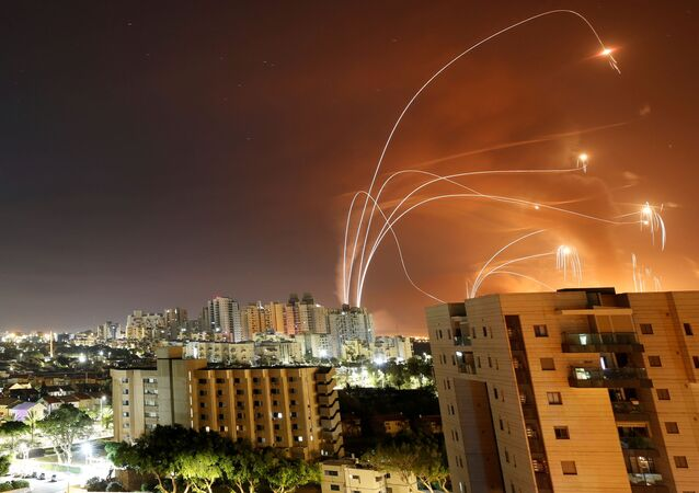 Streaks of light are seen as Israel's Iron Dome anti-missile system intercept rockets launched from the Gaza Strip towards Israel, as seen from Ashkelon, Israel, 12 May 2021.