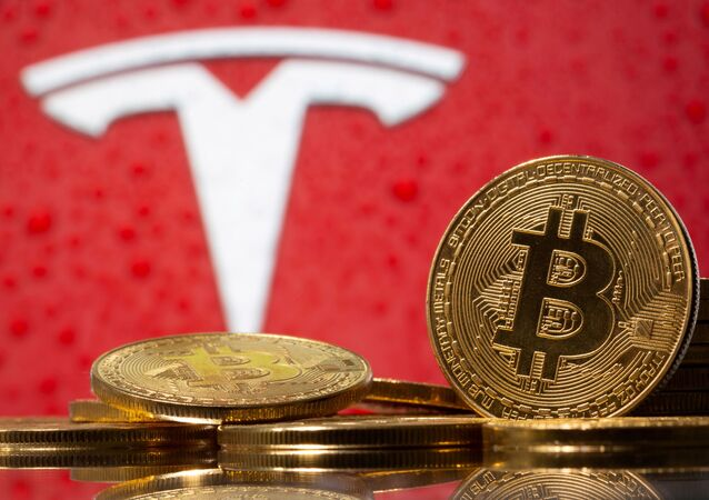 Representations of virtual currency Bitcoin are seen in front of Tesla logo in this illustration taken, February 9, 2021.