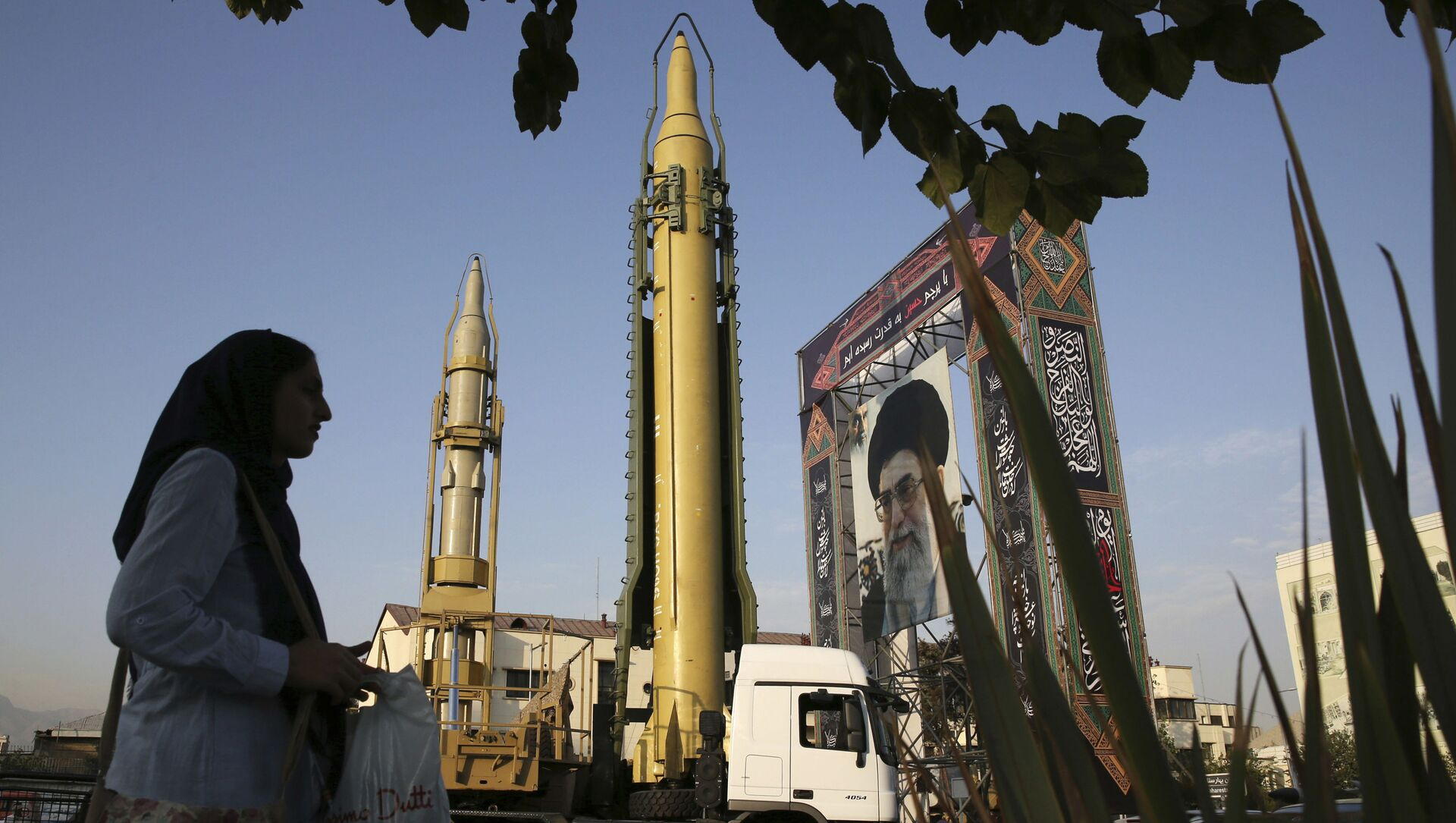 In this Sept. 24, 2017 file photo, surface-to-surface missiles and a portrait of the Iranian Supreme Leader Ayatollah Ali Khamenei are displayed by the Revolutionary Guard in an exhibition marking the anniversary of outset of the 1980s Iran-Iraq war, at Baharestan Square in Tehran, Iran. - Sputnik International, 1920, 27.07.2021