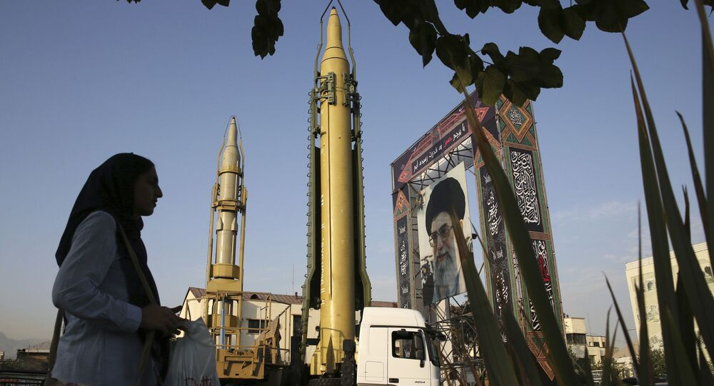 In this Sept. 24, 2017 file photo, surface-to-surface missiles and a portrait of the Iranian Supreme Leader Ayatollah Ali Khamenei are displayed by the Revolutionary Guard in an exhibition marking the anniversary of outset of the 1980s Iran-Iraq war, at Baharestan Square in Tehran, Iran.