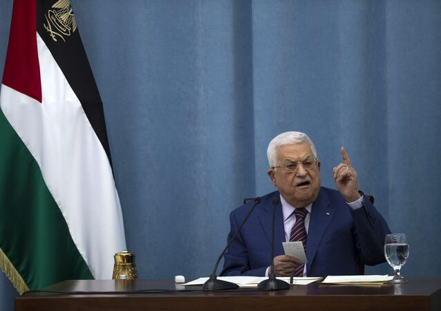 Palestinian President Mahmoud Abbas speaks a meeting of the PLO executive committee and a Fatah Central Committee at the Palestinian Authority headquarters, in the West Bank city of Ramallah, Wednesday, May 12, 2021.