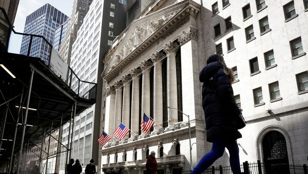 People are seen on Wall Street outside the New York Stock Exchange (NYSE) in New York City, U.S., March 19, 2021. - Sputnik International