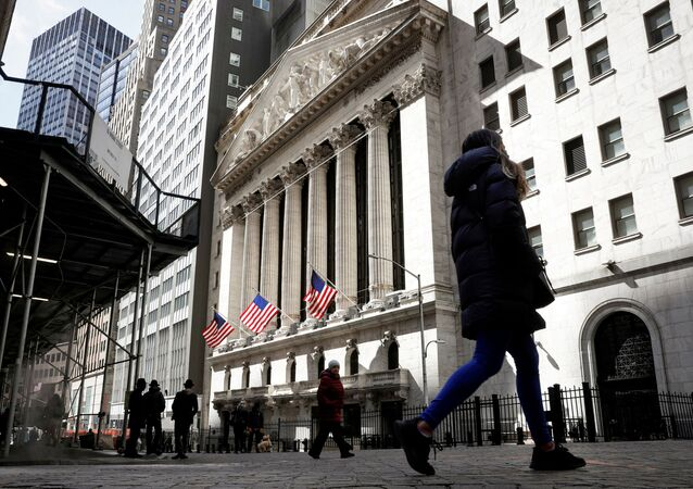 People are seen on Wall Street outside the New York Stock Exchange (NYSE) in New York City, U.S., March 19, 2021.