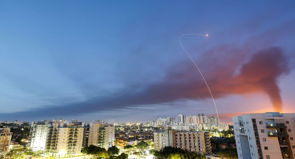 A streak of light is seen as Israel's Iron Dome anti-missile system intercepts rockets launched from the Gaza Strip towards Israel, as seen from Ashkelon, Israel May 12, 2021.