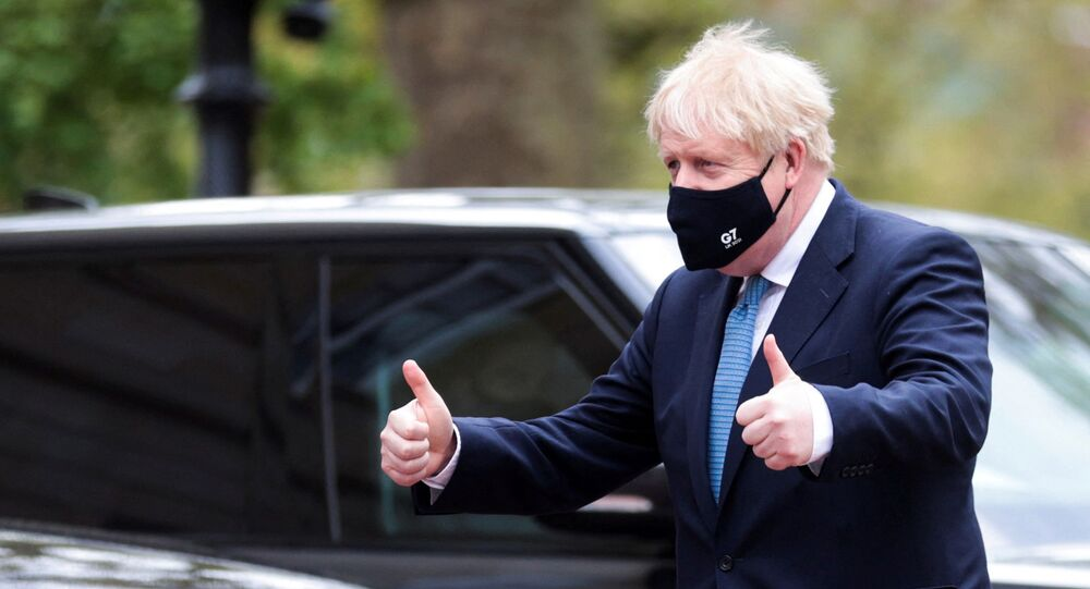 Britain's Prime Minister Boris Johnson makes a 'thumbs-up' gesture as he arrives at the G7 foreign ministers meeting in London on May 5, 2021