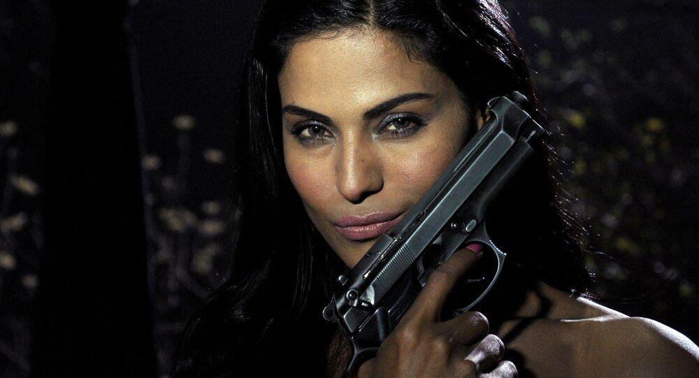 "Pakistani actress Veena Malik poses on the set of her forthcoming Hindi film ""Mumbai 125 kms"" in Mumbai on March 21, 2012"