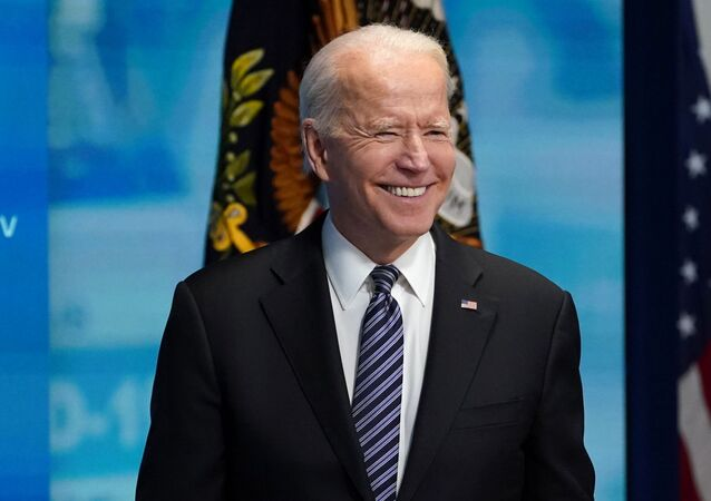 U.S. President Joe Biden smiles during a question from a reporter after speaking about the COVID-19 response and vaccination program at the White House in Washington, U.S., May 12, 2021