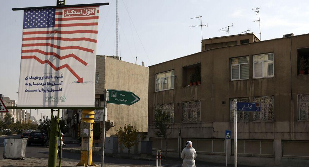 A pedestrian walks past an anti-U.S. billboard, in Tehran, Iran, Tuesday, Nov. 3, 2020