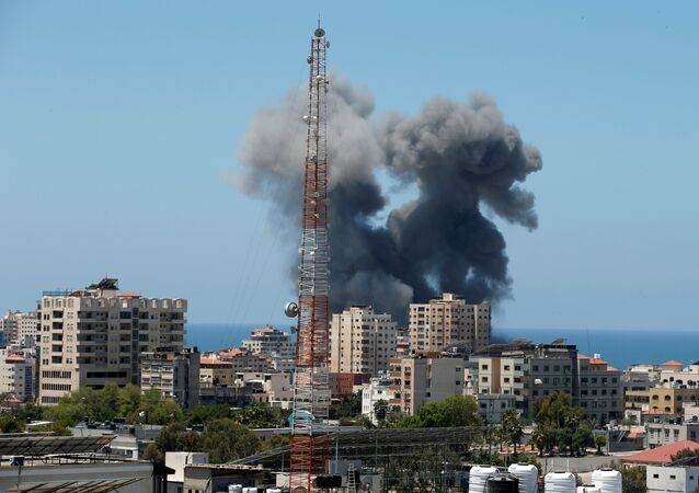 Smoke rises during an Israeli air strike, amid a flare-up of Israeli-Palestinian violence, in Gaza City May 13, 2021.