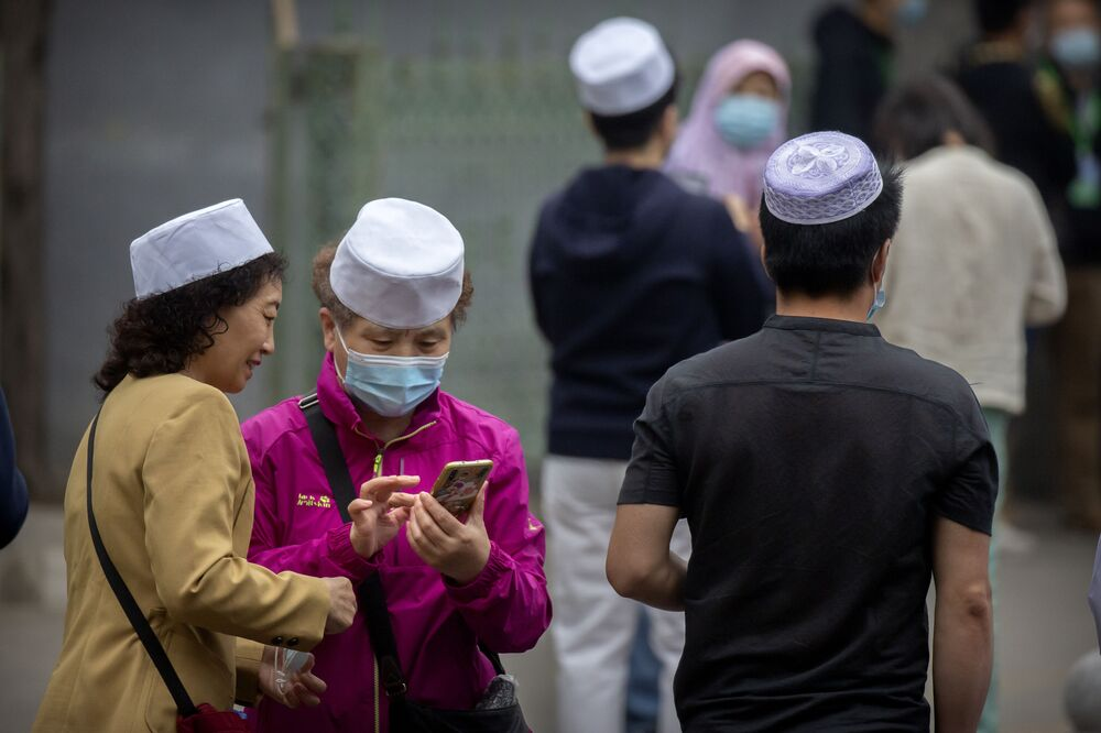 Muslims gather outside the Niujie Mosque before Eid al-Fitr prayer services in Beijing, China on 13 May 2021.