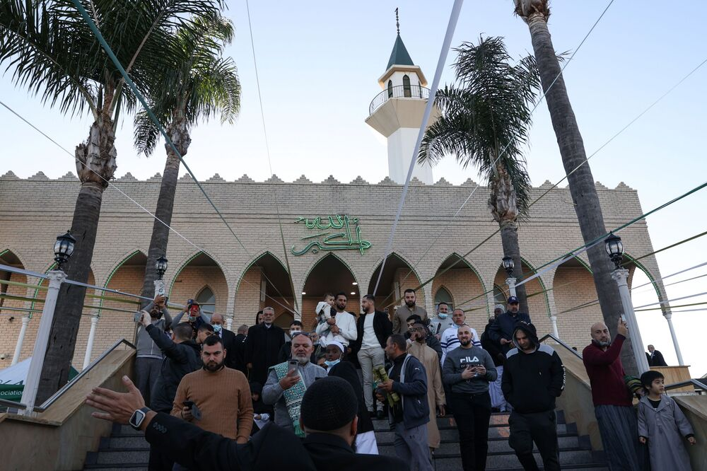 Muslim worshippers leave Lakemba Mosque, in the suburbs of Sydney, Australia, after observing the morning Eid al-Fitr prayer on 13 May 2021.
