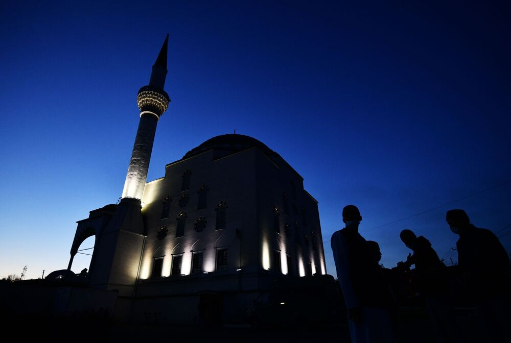 Muslims gather outside the mosque in Ekaterinburg, Russia, before Eid al-Fitr prayers on 13 May 2021.