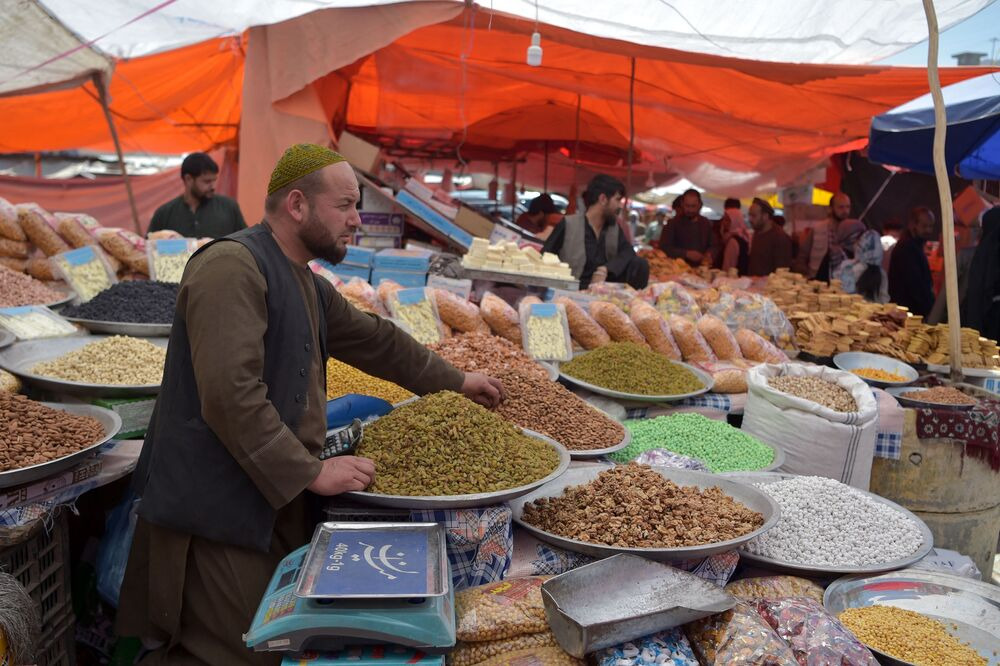 A vendor waits for customers at his dry fruit and sweets stall ahead of the Eid al-Fitr festival at a market in Kabul, Afghanistan, on 12 May 2021.