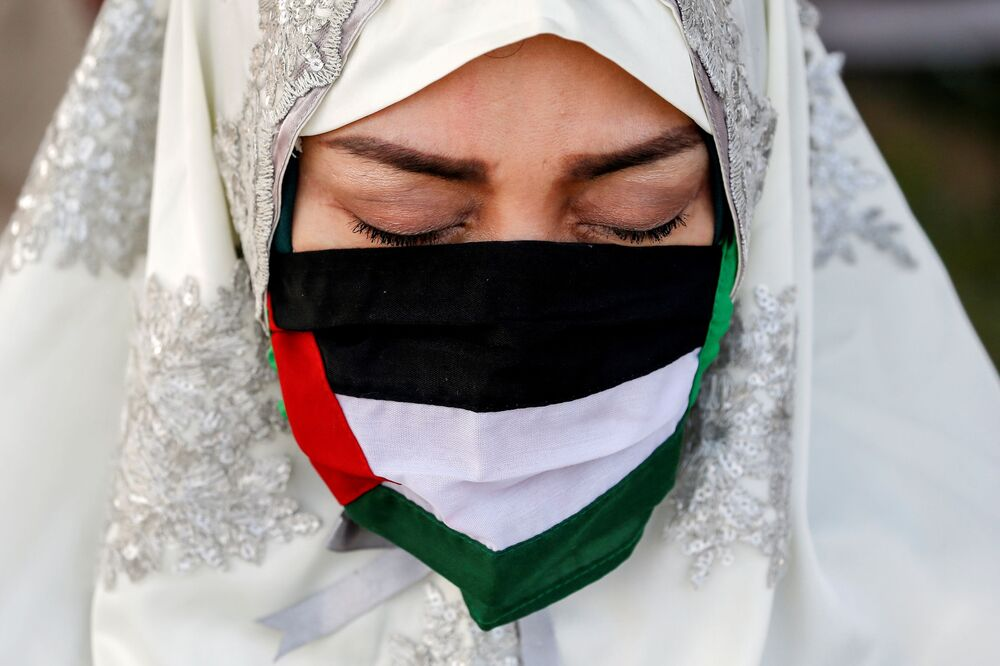 An Indonesian Muslim wears a face mask, designed in the likeness of the Palestinian flag, while praying at the Great Mosque of Al Azhar during Eid al-Fitr, marking the end of the holy fasting month of Ramadan, in Jakarta, Indonesia, on 13 May 2021.